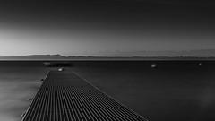 Sur le lac (MrMyz) Tags: sunset blackandwhite bw lake nature water monochrome canon landscape eos switzerland blackwhite eau noiretblanc outdoor nb paysage chemin leverdesoleil noirblanc exterieur eos5d poselongue nd1000 lacrivire lakeriverwater rmyb infinitexposure mrmyz