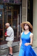 Youth and blues (Jun) Tags: barcelona blue summer woman hat azul youth 50mm calle mujer nikon young streetphotography oldman verano sombrero vestido decisive curvas juventud decidida