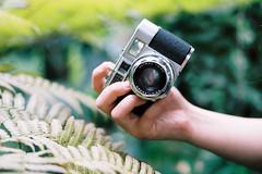 Tropical. (Hello i'm Wild !) Tags: analog film 35mm canonae1 kodakportra400 tropical fern nature plants hand skin girl filmcamera cameraporn rangefinder bokeh dof light