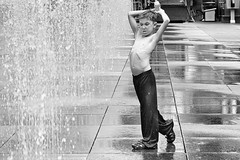 boy with can in fountain B/W (Jude Marion) Tags: blackandwhite bw toronto ontario canada waterfountain dundassquare