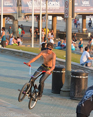 BMX Trickster (ScottS101) Tags: sansenbachmarinephotographyallrightsreservedcrowd people huntington beach event competition fun sun huntingtonbeach2016scottsansenbach allrightsreservedpier surf sand huntingtonbeach surfer wave pacific surfboard california ocean athlete wind waves water bmx bicycle trick stunt shirtless boy man male youth teen