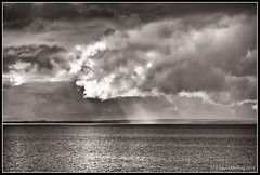 Rain and sun (mmoborg) Tags: sweden sverige lake sj clouds moln rays strlar weather vder
