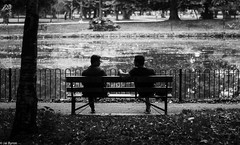 A Conversation (kungfuslippers) Tags: park alexandrapark manchester sel55f18z sonya7 sony ilce7 conversation mono blackandwhite candid bench
