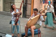 players (stevefge) Tags: krakow poland oldtown squares music instruments balalaika street people candid reflectyourworld