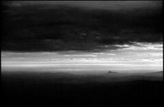 A view from the top of the hill (elkarrde) Tags: winter sky blackandwhite mountain film nature monochrome canon landscape blackwhite pentax kodak croatia hills telephoto february expired 500mm vivitar vignette kodakt400cn t400cn canoscan 400asa expiredfilm p5 twop series1 c41 chromogenic colornegative 2013 vuescan 8800f japetić jastrebarsko canoscan8800f pentaxp5 camera:brand=pentax film:brand=kodak justpentax canoncanoscan8800f location:country=croatia pentaxart vivitar500mmf8mirrorlens film:process=c41 film:speed=400 lens:brand=vivitar winter2013 developer:name=c41 location:city=jastrebarsko film:model=t400cn camera:format=135 lens:format=135 lens:mount=k camera:model=p5 camera:mount=ka vivitarseries1500mmf8 lens:model=series1500mm18 lens:focallength=500mm lens:maxaperture=8