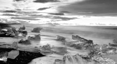 a gin tonic sunrise in Iceland (lunaryuna) Tags: ocean seascape monochrome sunrise season landscape dawn blackwhite iceland spring shore lunaryuna northatlantic diamondbeach southiceland beachcoast seasonalchange jokulsarlonglacierlagoon lightmood blackvolcanicbeach