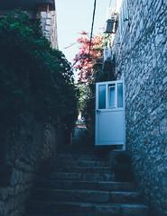 (adamdrazsky) Tags: pentax k3 hvar croatia street photography colour door aesthetic vsco fade faded agfa vista 400 sky steps stone wall building architecture