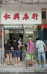 """""""watch"""" ... finally a busy day (hugo poon - one day in my life) Tags: xpro2 35mm hongkong northpoint kamhongstreet watch vanishing yesteryear shop busyday"""