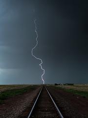 Railroad Lightning Bolt (John Finney) Tags: railroad usa storm weather vanishingpoint colorado lightning lightningbolt extremeweather stormchasing mcclave railwaylines tornadoalley