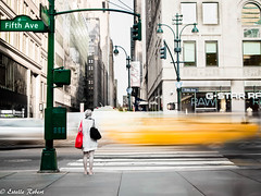 Lady with red bag (estellerobertnyc) Tags: street city longexposure red newyork yellowcab fifthavenue