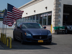 Matte Blue Maserati (A. Jarrett) Tags: maserati matte blue quattroporte flag