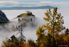 ABOVE THE CLOUDS . . .  (CANADA, BRITISH COLUMBIA, MUSKWA, FORT NELSON) (KAROLOS TRIVIZAS) Tags: canada britishcolumbia muskwa fortnelson summit peak fog mist hill trees mountain cloud sky atmosphere magical