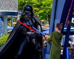 Young Padawan takes on Darth Vader (Kevin MG) Tags: usa losangeles anaheim orangecounty disney disneyland dlr starwars girls young youth pretty cute darthvader adolescent california