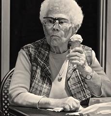 Lady with Cone (tvdflickr) Tags: bw white black senior monochrome lady georgia nikon cone eating streetphotography elderly icecream elder vest marietta frown plaid pendant candidportrait seniorcitizen d610 nikond610 photosbytomdriggers photobytomdriggers thomasdriggersphotography