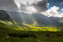 Beaming down. (ian.emerson36 (off for a week, going camping)) Tags: langdale lakedistrict landscape sunrays hills mountains greenery shrubs clouds valley rocks nationaltrust canon 1855mm
