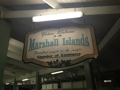 The famous sign of the Marshall Islands entering the airport.