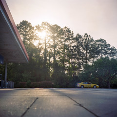Taxi (Daniel Regner) Tags: camera morning travel trees sky sunlight 120 6x6 film car station analog sunrise vintage lens photography prime coast focus bright florida kodak scanner top daniel cab taxi c south grain gas east iso waist level april handheld epson medium format 100 analogue shallow manual asa viewer finder yashica flatbed emulsion f35 ektar c41 2015 yashinon v500 regner