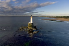 Rattray Head lighthouse from the air (iancowe) Tags: lighthouse beach rock sunrise dawn scotland aberdeenshire head scottish aerial stevenson stfergus drone fraserburgh peterhead northernlighthouseboard rattray nlb
