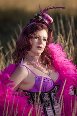 Saloon Girl Gone Bad-04 (eriknorderphotography) Tags: pink newzealand christchurch outdoors flash feathers burlesqueperformer sony70200f28g sonyalpha550