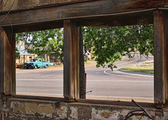 Paneless (Helen Orozco) Tags: wood newmexico window overgrown view frame weathered derelict sierracounty canonsl1rebel