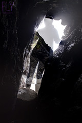 Gualala, California (tayler.mcclellan) Tags: ocean california light shadow selfportrait beach nature self canon dark myself leaving outdoors rebel coast shadows go cave past emerge gualala letting t4i