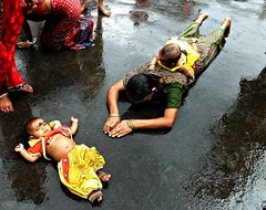 baby on her back, baby in front (s) Tags: india water children women babies ritual rite kolkata puja dondi penance kalighat sitala