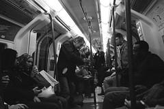violinist (laumel) Tags: bw london film public analog underground mju metro homeless tube olympus stylus plus hp5 epic mjuii ilford juosta
