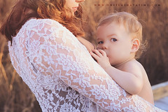 Asher (oneflashatatime) Tags: family boy woman baby sunlight love milk spring breast natural gorgeous mother son babywearing hippie breastfeeding crunchy bonding tula breastmilk liquidgold naturalparenting attachedparenting