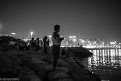 Fishermen of the night... (EHA73) Tags: leica nightphotography blackandwhite bw fishing dubai fishermen uae shoreline streetphotography dubaicreek leicamm aposummicronm1250asph typ246