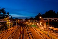Dusk over the bridge (Giannis Samartzis) Tags: poznan poland dusk sunset rails train station nikon d60 polska lights night long exposure blue yellow bridge most teatralny