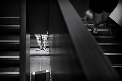Escape (V Photography and Art) Tags: monochrome blackandwhite black white contrast legs running runningaway candid steps stairs man woman