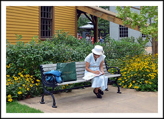 Pausing to Plan Her Visit to the Old Car Festival (sjb4photos) Tags: michigan dearborn greenfieldvillage bench benchmonday hbm 2016oldcarfestival