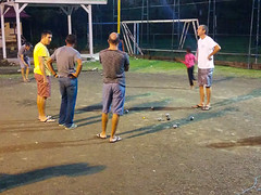 Evening Boules in Tartane (DJ Greer) Tags: woman holiday man male men field female standing ball island evening stand martinique steel carribean round tropical boules boule tartane