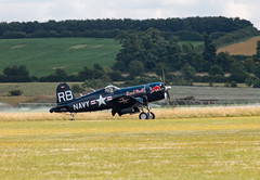 Red Bull Corsair landing (Beth Hartle Photographs2013) Tags: duxford aircrafts historicaircraft redbull p38 corsair