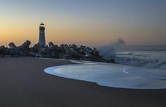 Splash (corybeatty) Tags: walton lighthouse beach ocean rocks waves wave crashing color sky morning sunrise water sea