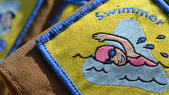Swimmer (mitchell_dawn) Tags: macromondays brownies guides badge sport olympics summer childhood sash yellow summerolympicsports swimming swimmer water