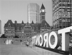 Old City Hall from New City Hall (ScreenPotato) Tags: toronto ontario canada nathanphillipssquare oldcityhall cityhall fuji fp3000b schneider 90mm superangulon sinar bw