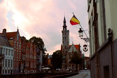 Flemish sunset (sa1_m0ne) Tags: colorful snapshot visiting brugge bruges belgium belgique europe 2015 beautiful flag church city steeple janvaneyck vlaams architecture