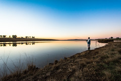 Fishing at Sunset (marccrowther) Tags: nikon d7100 nikond7100 1024mmf3545g nikon1024mmf3545 1024mm ultrawideangle ultrawide sunset southafrica kamberg drakensberg dam fishing fisherman calm trout landscape
