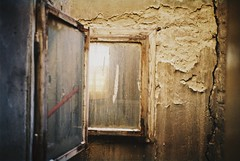 Sok v (Moesko Photography) Tags: analogue nikon nikonl35af window home budapest wall geometry abstract indoor house glass reflection dirt