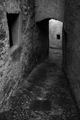 Intriguing little lane (Lucky Poet) Tags: italy lagodicomo lakecomo loveno alley architecture archway blackwhite monochrome old passageway