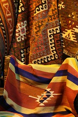 Vibrant Traditional Textiles Al-Madina Souk An Afternoon in Aleppo, The Ancient City that Was October 31 2010 Syria Middle East (eriagn) Tags: travel art history tourism wool rock fruit architecture concrete religious photography wooden traffic citadel minaret traditional prayer religion middleeast streetphotography documentary mosque tourist tourists unescoworldheritagesite traveller textures syria souk historical produce bazaar dailylife textiles fortification moat fortress weaving income citizens aleppo hawkers syrian bathhouse suq shopkeeper marked beliefs ngaire mosqueinterior ancientcity umayyadmosque orientalrugs camelhair medievalbuilding ceilingdecoration oldwalledcity citadelofaleppo traditionaltextiles eriagn ngairehart almadinasouk syrianstreetfood syrianpostbox