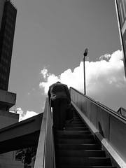 Hunched (isdavidisgood) Tags: work blackwhite candid escalator streetphotography australia brisbane briefcase