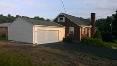 24' X 24' Reverse Gable with 16' X 7' overhead door and 8' high walls