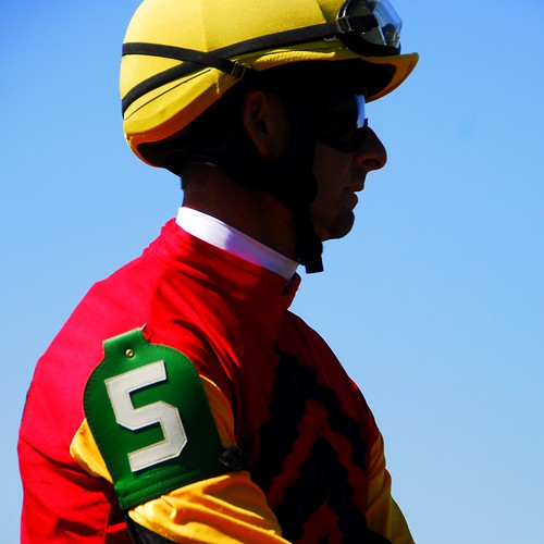 Tri-colored number five jockey