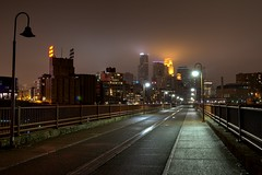 StoneArch in Fog M3sb (Greg Riekens) Tags: city bridge usa minnesota fog skyline night lights nikon downtown foggy minneapolis stonearchbridge flickrelite d7000