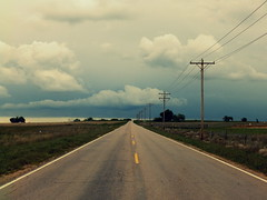Into the Storm (JC Shamrock) Tags: road clouds rural stormy east yellowline middleoftheroad countyroad22