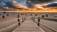 Down to the beach (Stefan Sellmer) Tags: light sunset sky color beach water clouds germany de deutschland sand colorful flickr outdoor northsea beachchairs schleswigholstein stpeterording sanktpeterording