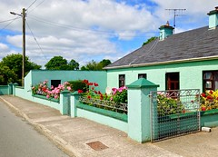 Colourful cottage (JulieK (moving house, very busy)) Tags: ireland roses green wall rural village pole broadford limerick htt iphone5 telegraphtuesday
