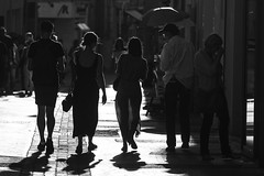 Walking On Sunshine (Cornelli2010) Tags: canonef70200mm14l canoneos5dmarkiii bw backlight backlit blackandwhite candid france gegenlicht menschen people schwarzweis streetlife streetphotography
